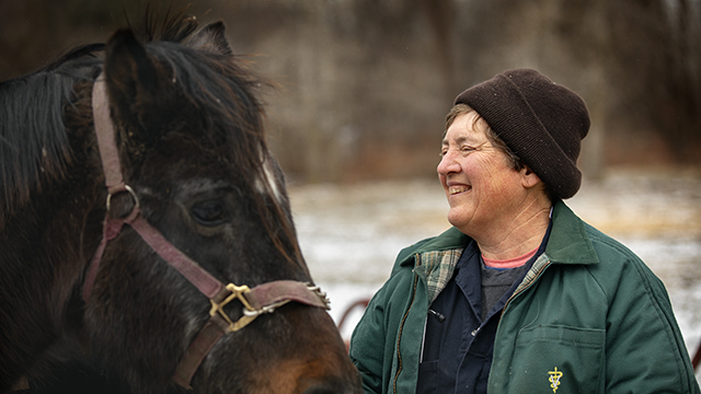 Dr. Barbara Mix stops by a stable near Horseheads, New York, to check on an injured show horse.