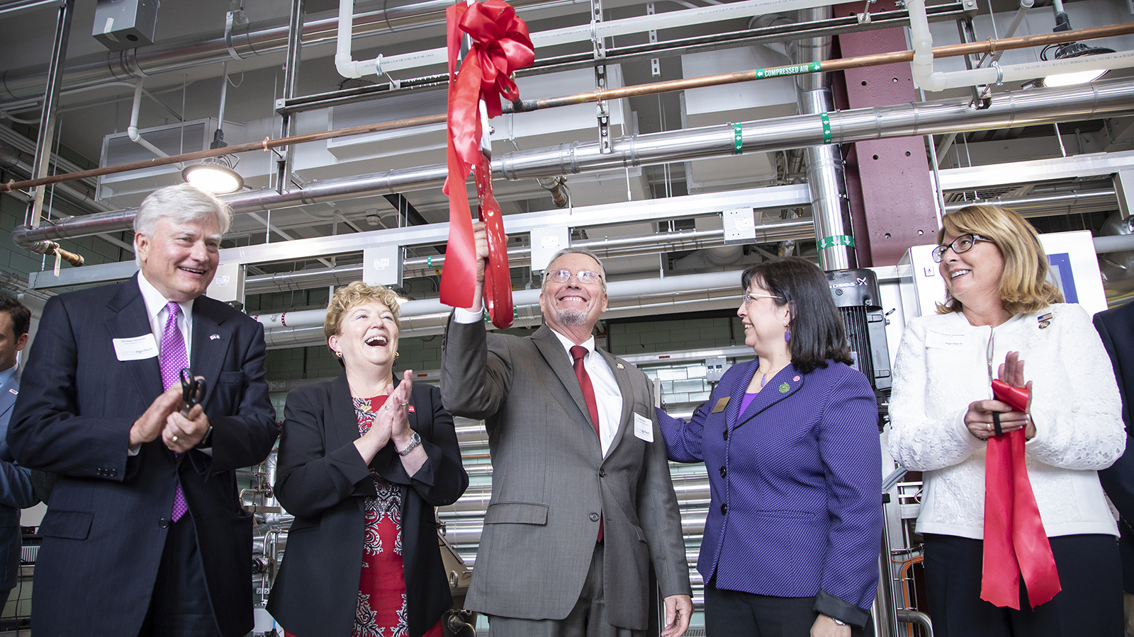 Cutting a ribbon.
