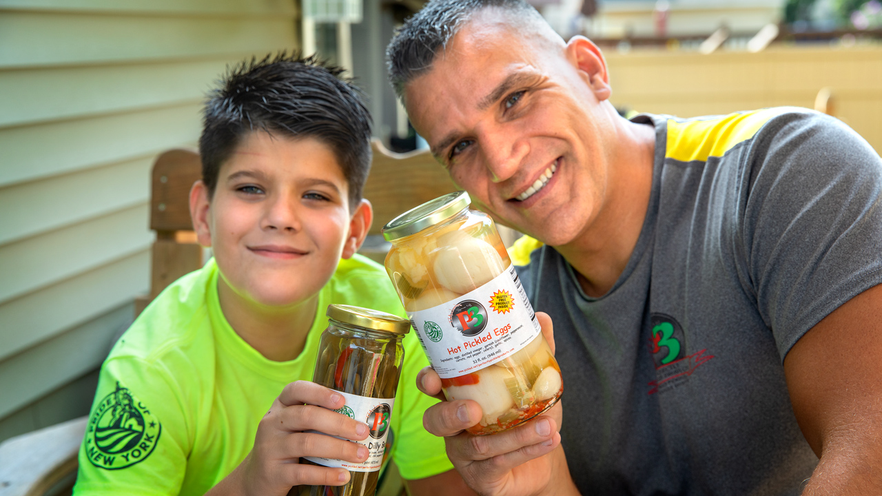 Mike Trudell, founder of Perfectly Pickled Products and his son.