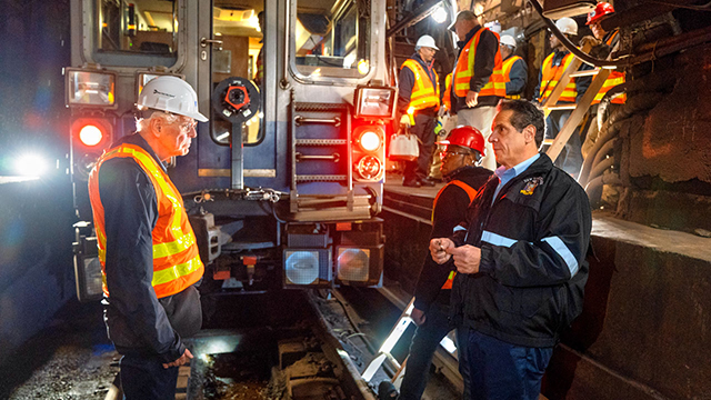 Professor Tom O'Rourke, speaks with Gov. Andrew Cuomo during a tour of the Canarsie Tunnel.
