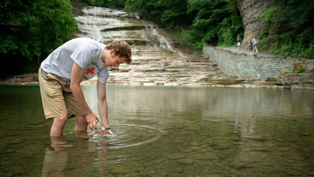 Testing water at Buttermilk Falls state park.