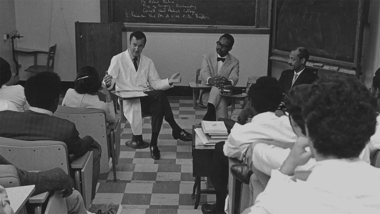 Participants in the 1969 travelers program sit in a classroom.
